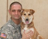 Yet another happy family together at last! Click to reunite soldiers with their pets!