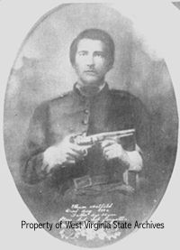 """Ellison Hatfield in Civil War uniform. His brutal murder in 1882 ignited the famous Hatfield-McCoy Feud. The inscription at bottom of photo reads: """"Ellison Hatfield Died Aug 1882 Father Age 33 years Gone but not forgotten."""""""