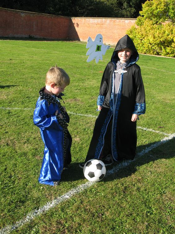 Spooky little wizards playing Halloween Phantom Football in the Walled Gardens at Holkham. www.holkham.co.uk