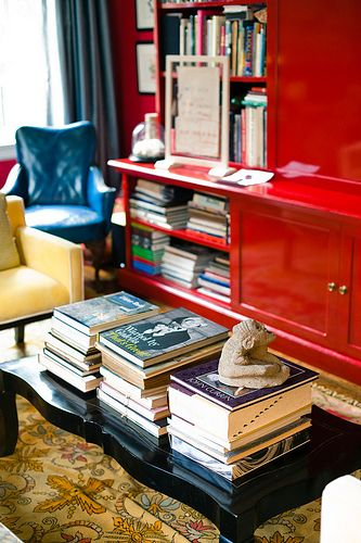 Red lacquered bookcase.