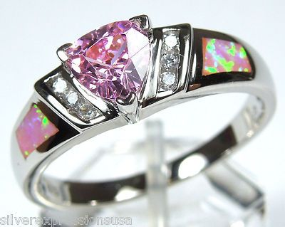 Trillion cut pink topaz with side fire opal stones.