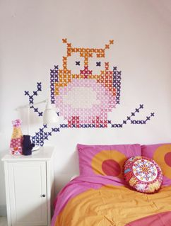 Cross-stitch style painted owl. I like how it fits around & frames the furniture in the room.