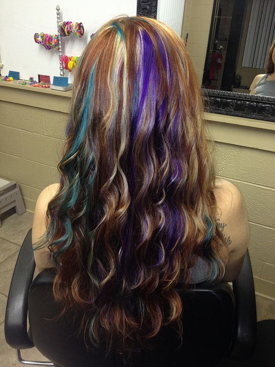 Audrey's auburn hair with blonde, purple, and teal highlights