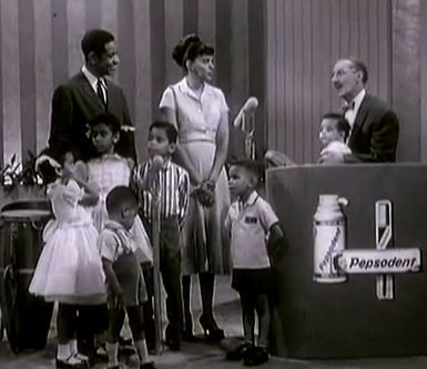 "The Sylvers family on ""You Bet your Life"".  To the far left of father Leon is Charmaine.  In front of Charmaine, stands Edmund.  Directly in front of Leon Sr. is Olympia.  To Olympia's right is Leon