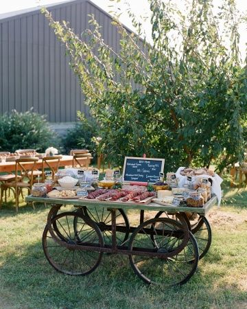 An old wagon was a great base for a charcuterie station. Not far away, fresh kettle corn was popping, and beer and wine was served from a canoe bar.