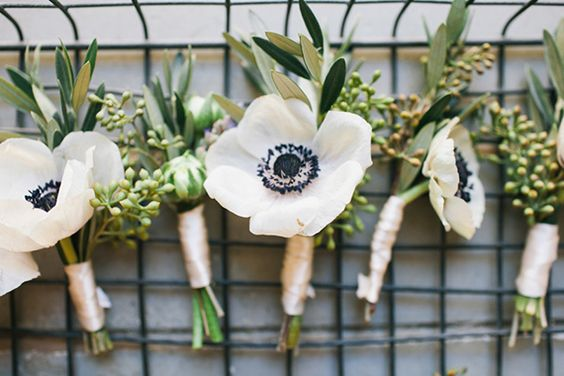 Anemone boutonniere | photo by Shannen Natasha Weddings | Read more -  http://www.100layercake.com/blog/?p=71772