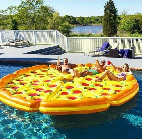 Giant pizza pool toy. I think they actually just put a bunch of single slice pizza pool toys and put them together to form a big pizza.: