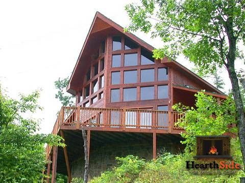 SWIMMING POOL ACCESS, GREAT MOUNTAIN VIEWS, SMALL PET-FRIENDLY, LOTS OF GLASS WINDOWS FOR YOUR VIEWING PLEASURE. You will be amazed how far you can see from these decks. This mountain view will just wow you!   This is a very spacious log home with floor-to-ceiling glass all across the deckside. Enjoy the regulation size pool table in the evenings after a day of all the fun activities downtown in Pigeon Forge (about 15 minutes from downtown).