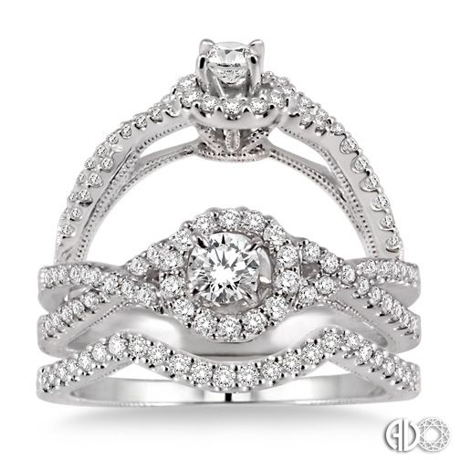 14K White Gold Halo Vintage Wedding Set.    http://www.thediamondstore.com/products/engagement-rings/14k-white-gold-vintage-wedding-set-%7C-ash24852/6-707