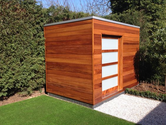 Luxury iroko garden shed available in a variety of sizes for Luxury garden buildings