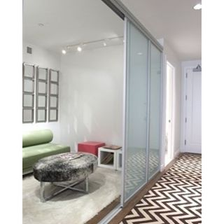 There are some rooms where a regular-old wall just won't do. Elevate your interior with indoor glass solutions from The Sliding Door Company.