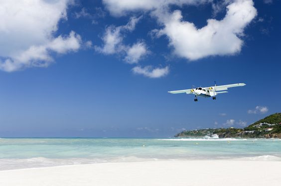 Airplane flying over the beach in St Barts