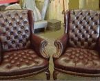 I remember an old chair, a recliner, done up in this fashion. It could have stood some specialty furniture restoration. But I loved the feel of the material, the way it was cool when I'd first sit down on it, and the way the seams were held together by those brass liners.