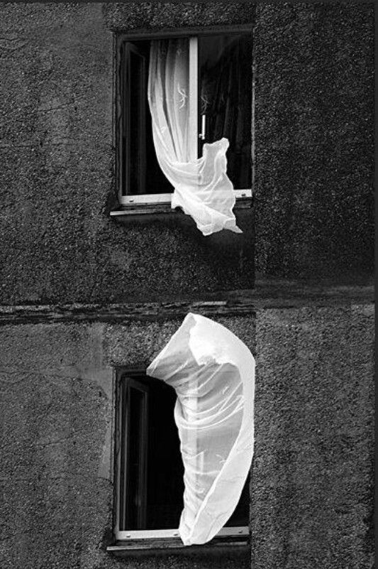 Curtains blowing in the wind. Atmospheric B & W shot.:
