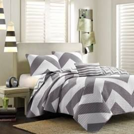 Mi Zone Libra Twin/Twin XL Coverlet Set in Grey - Olliix MZ80-337 Update the look and feel of your bedroom with the Mi Zone Libra Coverlet Set. An oversized chevron pattern is displayed in vibrant grey and white hues, while a smaller scaled grey and white chevron adorns the reverse.  Both the coverlet and sham(s) are fully reversible, giving you the option to mix & match the different chevron prints and customize your bedroom. An oblong pillow with fabric manipulated details adds charm and dimen