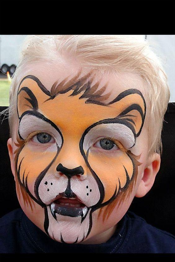Lion face paint - wild animal face painting ideas #snazaroo #facepaint