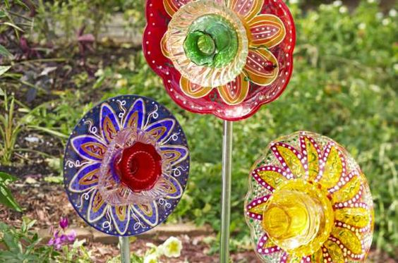 Learn how to make glass garden flowers from old plates, bowls, candleholders, and more. This recycled crafts project can be as simple or fancy as you like.