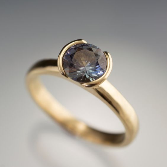 Hey, I found this really awesome Etsy listing at https://www.etsy.com/listing/167270083/large-round-tanzanite-half-bezel