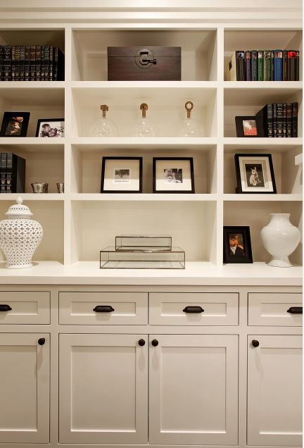 The dark hardware contrasts beautifully with the white built-ins. Color: Morning Dew OC-140 by Benjamin Moore: