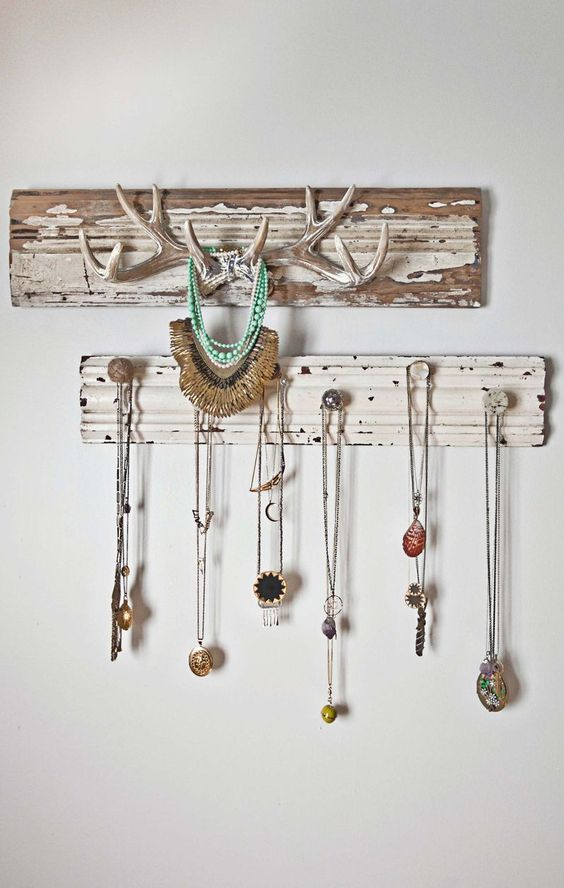 Love the deer antlers for displaying jewellery - Emma's bedroom tour abeautifulmess.com