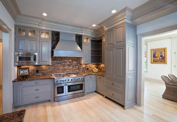 Shades of grey in kitchen for understated elegance. Stone splash adds the warmth.