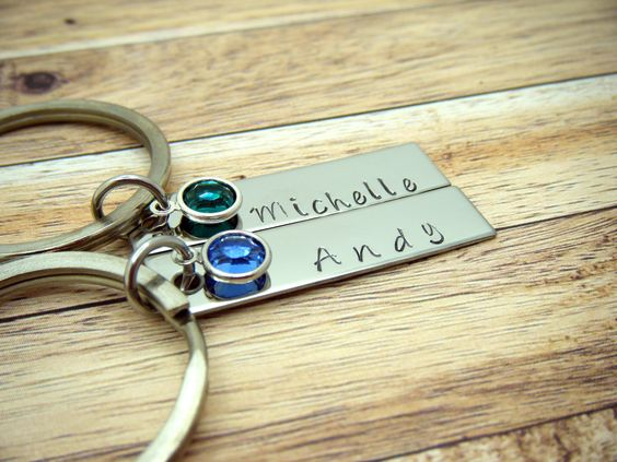 Great personalized keychains Gift for him or Gift for her. Personalized keychains hand stamped with your personalized names and a Pink and Blue birthstone charm connected to the jump ring at the top.