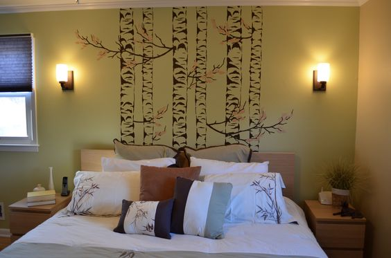 The bedding we chose for this room echoes the idea of the hand painted stencil on the wall. The birch tree stencil over the bed is to promote relaxation with the idea of infusing nature into the design.