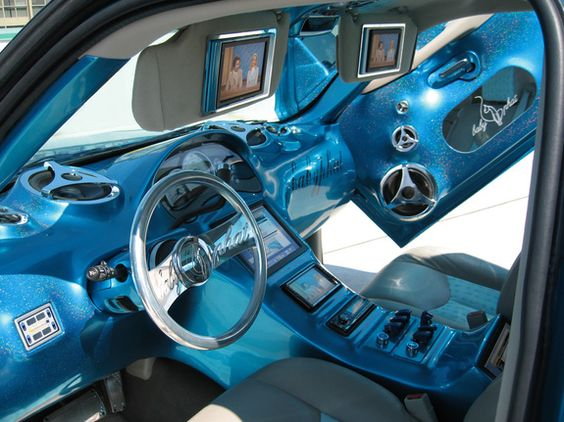 Cars: Tanesha's dream car interior, Baby Phat! She'd love this! Maybe not the color, but the Baby Phat.