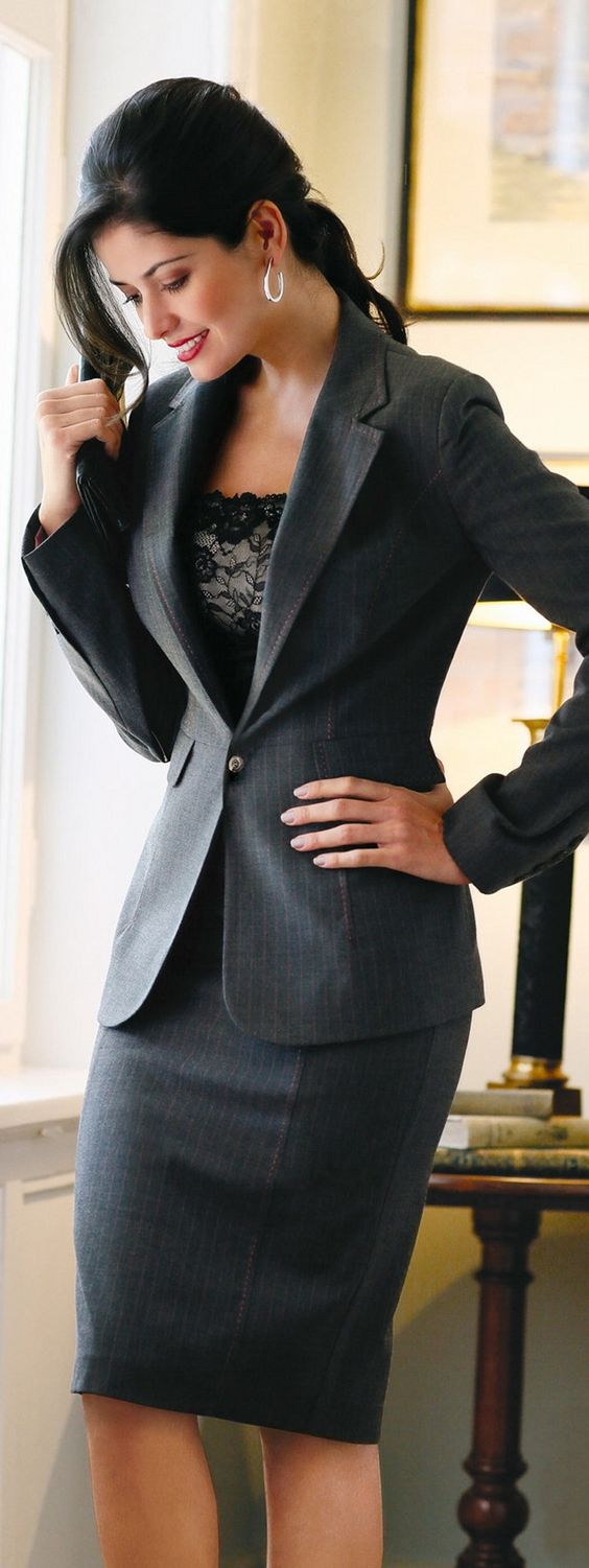 A sleek charcoal suit presents a clean and professional look. Paired with a nice blouse and accessories, this outfit is perfect for anywhere that a business formal look is required.