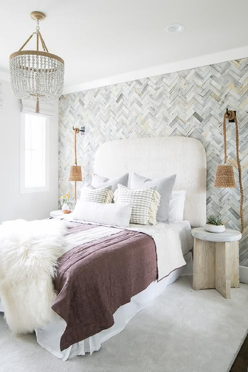 Gray herringbone pattern wallpaper covers a bedroom accent wall fitted with rope hanging lamps positioned over round wood and concrete bedside tables. | Wallpaper For Teenage Girl Room |  Teenage Bedrooms  | House Beautiful Teenage Rooms | Tween Boy Bedroom Ideas On A Budget. #painting #Interior