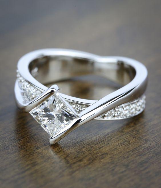A Beautiful Bezel Bridge Princess Cut Diamond Engagement