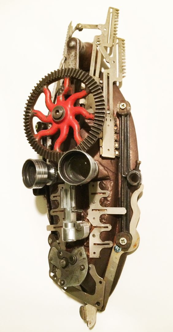 """Red Storm"" found object assemblage mask using antique typewriter and adding machine parts by Assemblique™"
