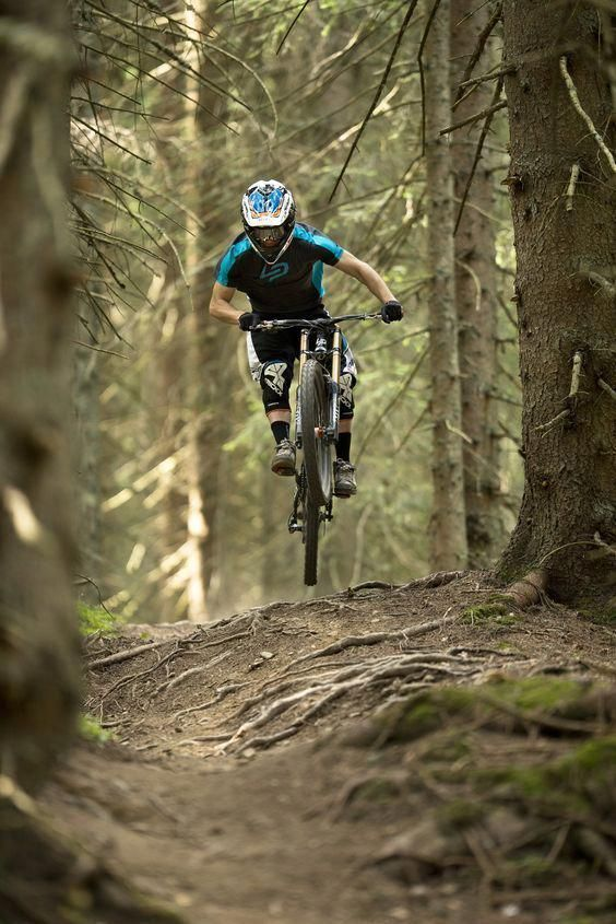 A Downhill Mountain Bike Is A Full Suspension Bicycle Designed For Downhill Cycling On Parti Mountain Biking Photography Downhill Bike Downhill Mountain Biking