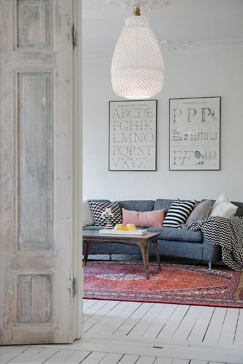 Grey with Persian (?) rug and white floorboards: