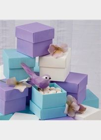 """Easy to assemble favor box with lid comes in a variety of colors sure to coordinate with your wedding theme. Use them for holding candies and other treats that you plan to give away at your reception. Size: 2"""" x 2"""" x 2"""". Favor Box Dimensions: 2"""" L x 2"""" W x 2"""" H.  View Color Choices"""