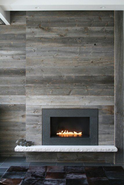 10 fireplace surrounds with beautiful wooden wall panels for Fireplace wall