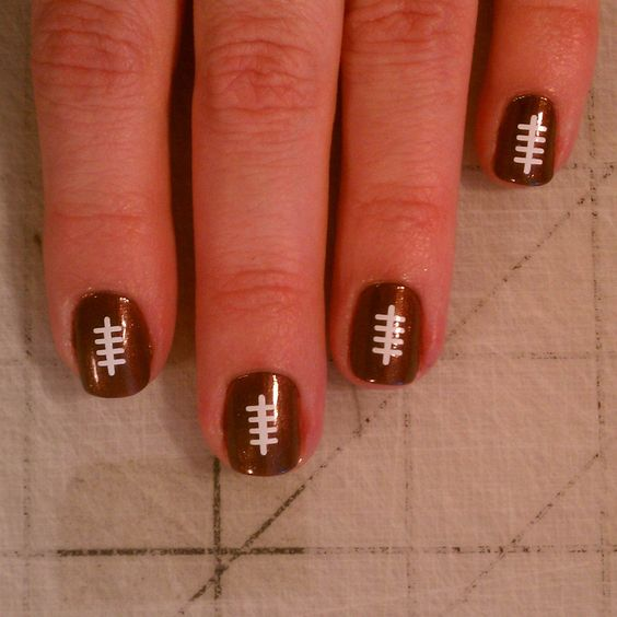 Football nail art. Game season, here we come!    The only city where the teenagers get into football season as much (or even more) then the adults!!    Gotta luv the black 'n gold!