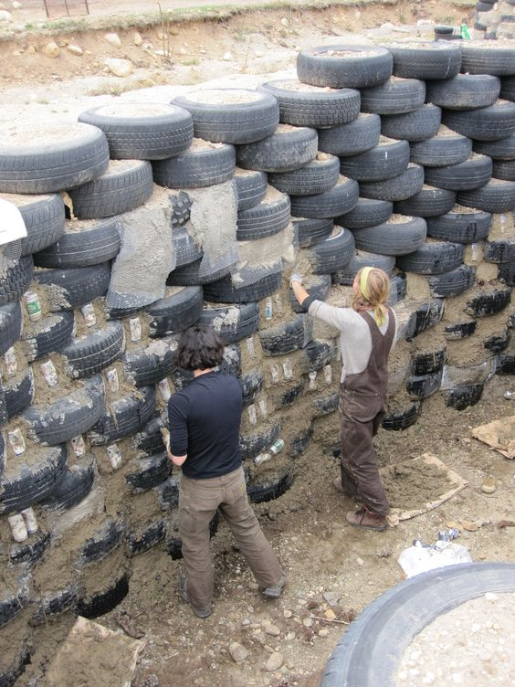 earthships | the mudders filling in the tires check out those pants