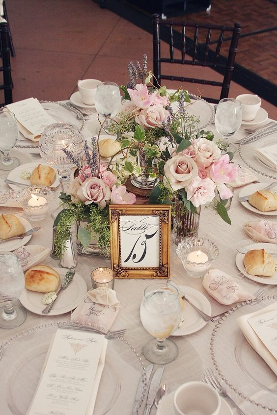 Wedding in MBH tent summer 2012 - pretty centerpieces with smaller arrangements and some candles