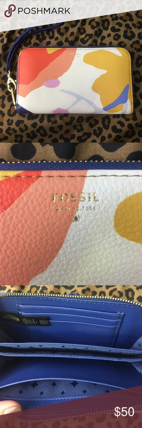 Fossil wallet! Fossil wallet with wristlet attachment. Never used, just been sitting in my closet. 3 card holders on the inside. Coin pouch on the outside. Willing to take offers! Fossil Bags Wallets