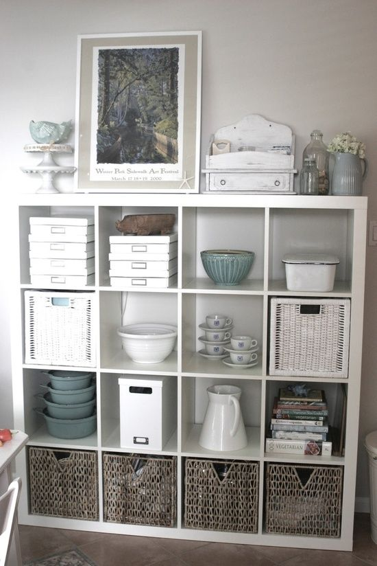 ikea Expedit shelve styling - this might be great in the living room as overflow storage for kitchen items, or even in dining against kitchen window wall!: