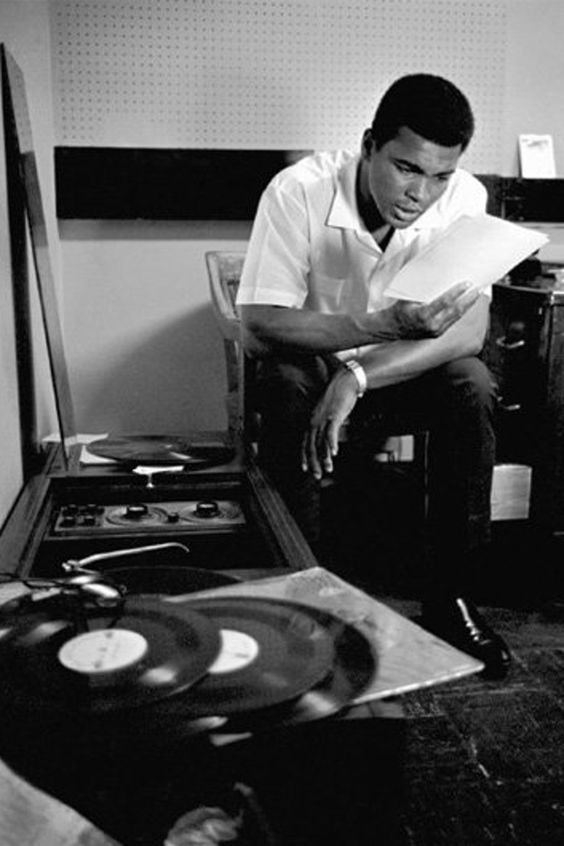 Muhammad Ali with records and record player: