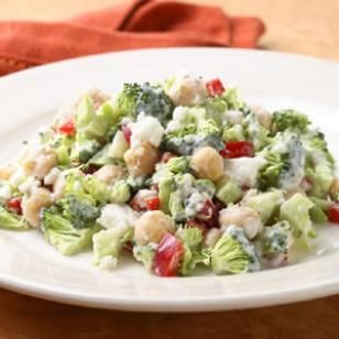 Broccoli Salad with Creamy Feta Dressing   Finely chopped raw broccoli is tender and mild--here it's tossed with a creamy dressing, meaty chickpeas and sweet bell pepper.