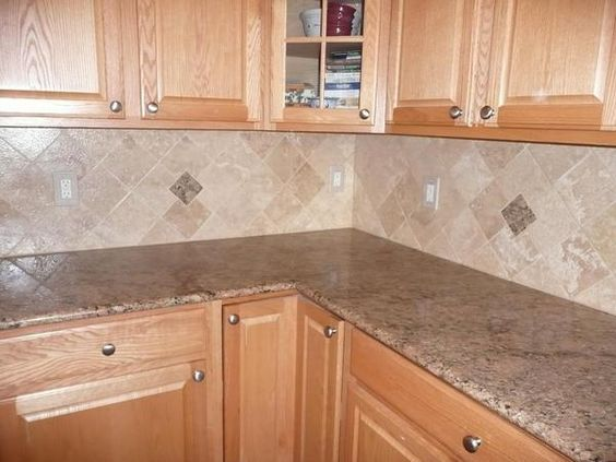 Honey color wood with this giallo veneziano granite is a great contrast and pulling it into smaller sections of the backsplash helps continue the look. It definitely has a comfortable but slightly wild feel.