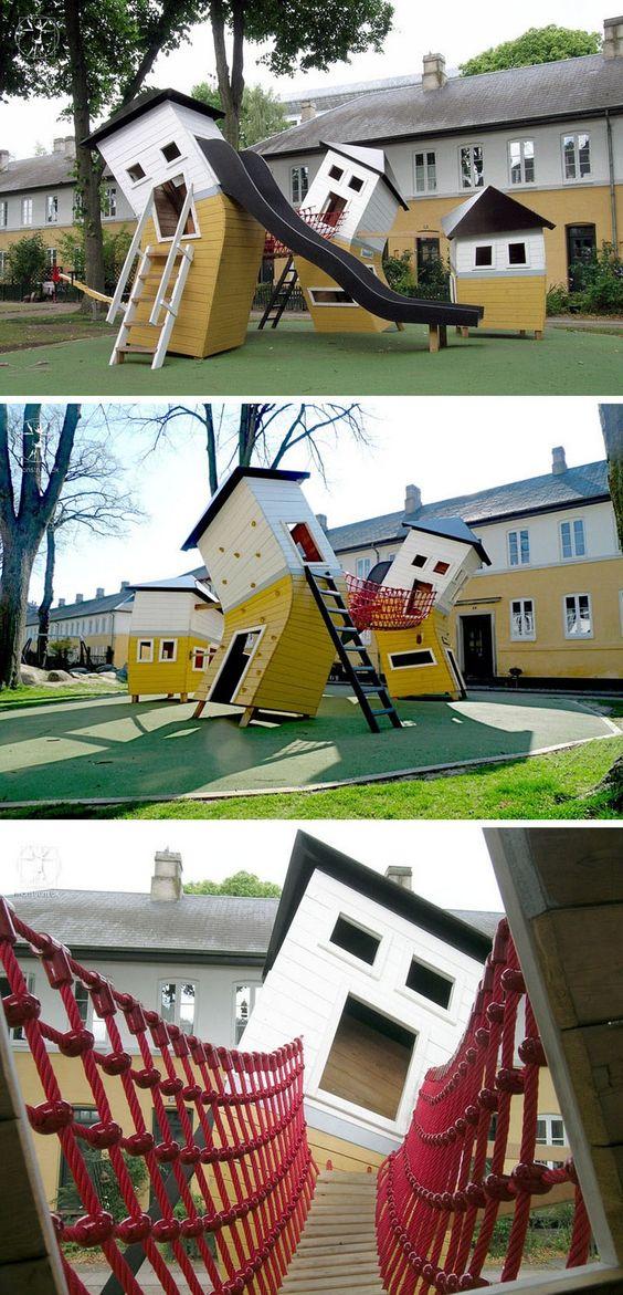 Unübliche Spielhäuser mit Kletterwand, Seilbrücke und Rutsche - ein Paradies für Kinder