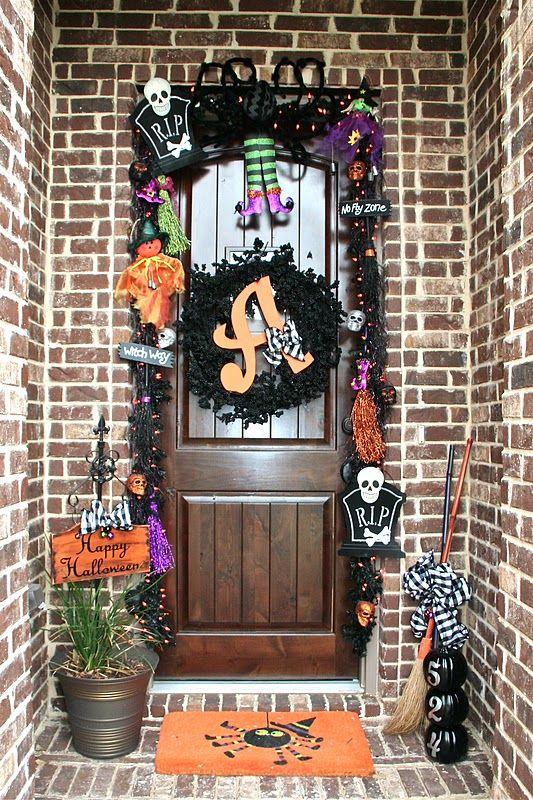 Halloween door decor. Super cute! Love the Halloween monogram wreath and the witch legs.