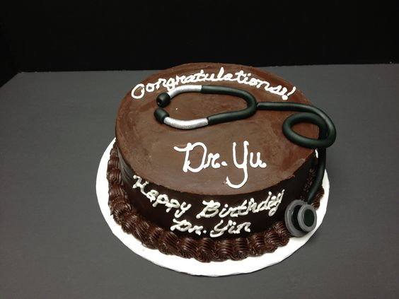 Chocolate cake with chocolate ganache icing for a combined medical school graduation and birthday party. Fondant stethoscope.