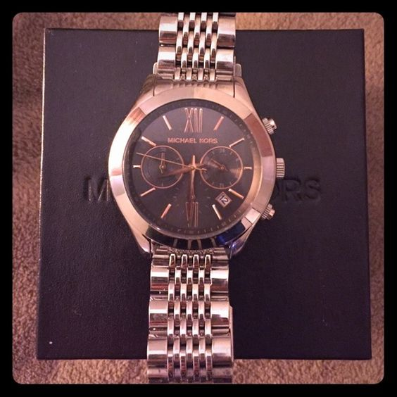 Michael Kors Silver Watch with Grey Face MK watch has signs of wear including scratches on the body and face. I got some links taken out about 2, but I can no longer find them. Comes with box and care card. Box is slightly worn as well. Thanks for looking! Michael Kors Accessories Watches