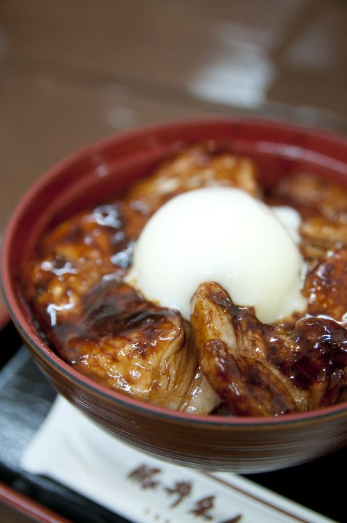 Japanese pork rice bowl with half-boiled egg as a topping
