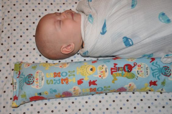 """flannel """"sock"""" filled with rice. Nuke for 1 minute. Baby is convinced that the warm sock is a warm momma and sleep ensues for all."""